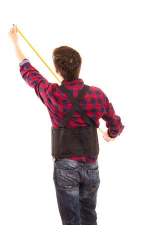 man with measuring tape handyman on white background photo