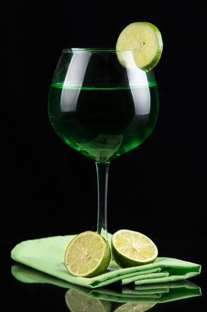 lemon drink in a wine glass photo