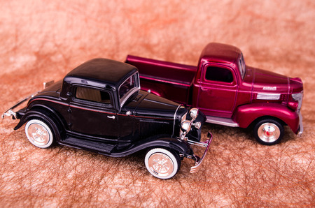 Vintage toy cars in an old background photo