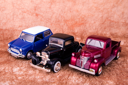 vintage toy cars in white background