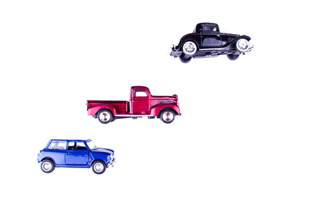 vintage toy cars in white background photo