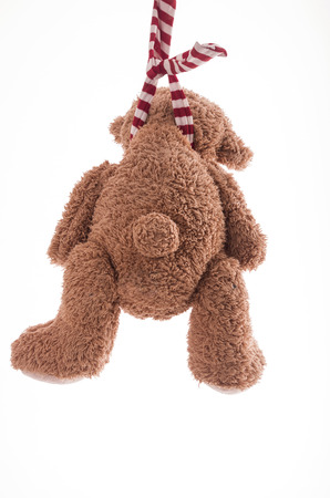 Image of teddy bear who is committing suicide by hanging itself photo