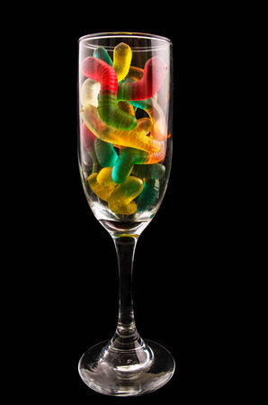 gummy: gummy bears  and a wine glass on a dark background