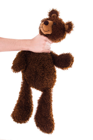 strangling: strangling a brown teddy bear isolated on white
