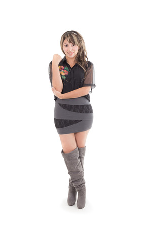 latin girl in grey black dress and long boots isolated on white