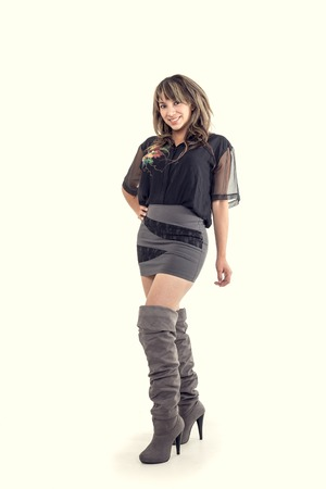 stylish hispanic girl posing with hand on her hip isolated on white photo