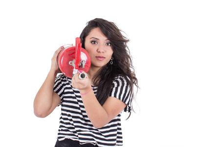latin girl holding fire extinguisher isolated on white photo