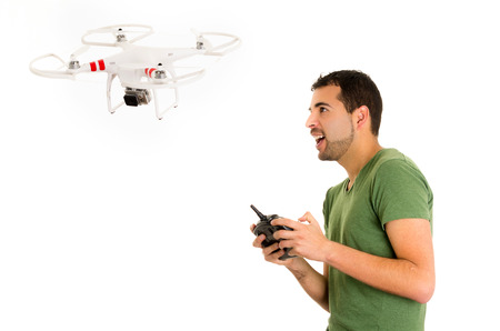 heli: handsome young man with quadcopter drone isolated on white Stock Photo