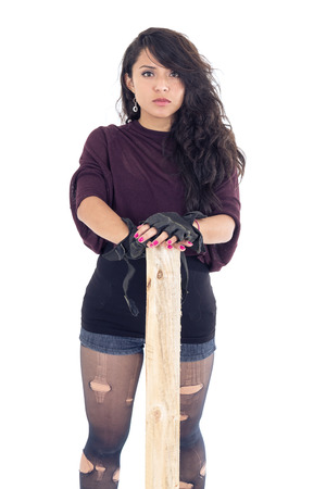 punk young girl with pice of wood isolated over white photo