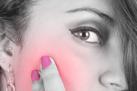 enhanced health: girl s face with pain in cheek color toned pink closeup