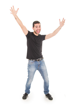 handsome happy guy posing with arms up isolated on white photo