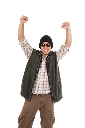 hispanic man posing as a winner wearing sunglasses and beanie isolated over white photo