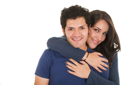meant to be: close-up hispanic young couple wearing blue clothes hugging isolated on white
