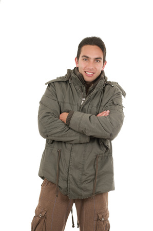 satisfied young man wearing green jacket posing crossing arms isolated over white photo