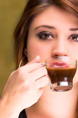 closeup of a beautiful young girl drinking coffee photo