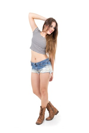 5ce28cf675571 beautiful girl wearing shorts and crop top with hand on her long blond hair  isolated on