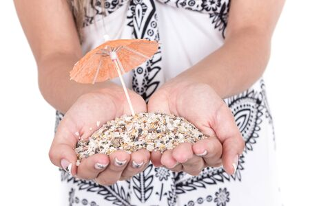 mini umbrella: hands carrying sand with one mini umbrellas concept of holidays isolated on white
