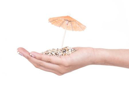 mini umbrella: sand on hand with mini umbrella concept of beach isolated on white Stock Photo
