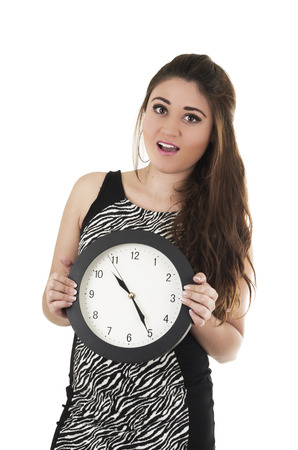 Beautiful young surprised woman holding big round clock isolated on white time concept photo