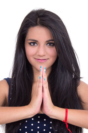 salutation: Closeup of beautiful young smiling girl doing yoga salutation