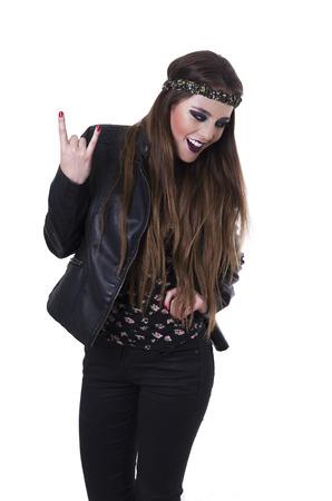 hairband: Beautiful happy teenage girl wearing black leather jacket gesturing rock on isolated on white