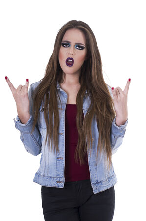 outraged: Beautiful teenage blond punk trendy girl gesturing rock on looking outraged isolated on white