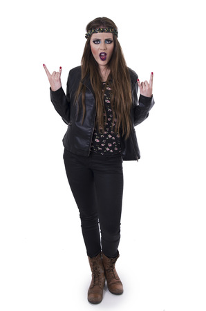 Gorgeous young rebel hippie rocker girl gesturing rock on with both hands isolated on white photo