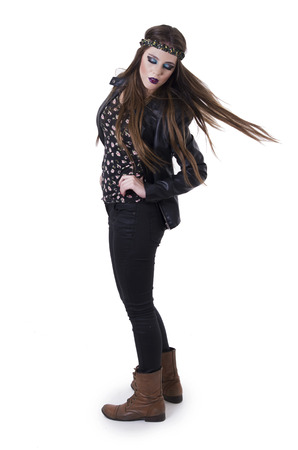Beautiful young hippie rocker funky fashionable girlwith flying hair isolated on white photo