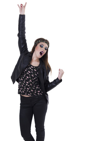 Pretty cool dark rocker trendy young brunette girl singing gesturing rock on isolated on white photo