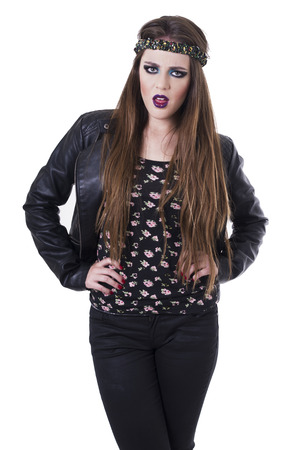 outraged: Beautiful teenage girl wearing black leather jacket looking outraged isolated on white