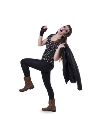 anarchism: Beautiful young rocker girl dressed in black carrying leather jacket isolated on white
