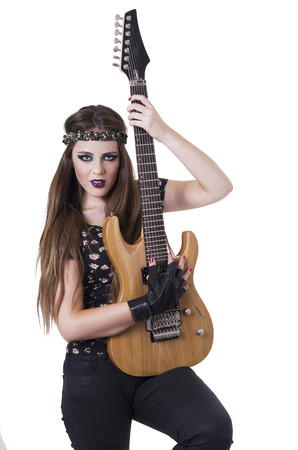 anarchism: Half length portrait of Young pretty blond rocker girl playing electric guitar isolated on white