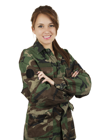 Happy teenage young girl wearing green military jacket smiling crossing arms isolated on white photo