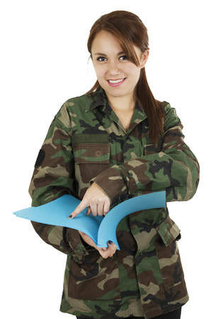 Young smiling teeange girl wearing military jacket carrying plastic folder isolated photo