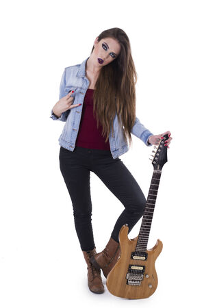 Beautiful rocker rebel girl with electric guitar gesturing rock on isolated on white