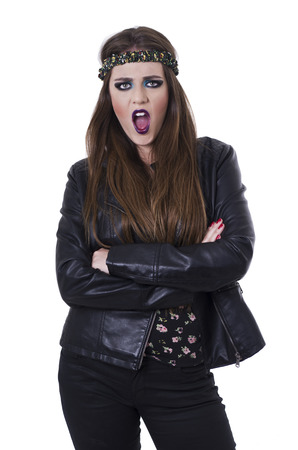 outraged: Sexy young rebellious rocker punk woman in leather jacket looking surprised isolated on white Stock Photo