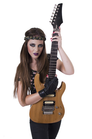 Young pretty blond rocker girl playing electric guitar wearing black glove isolated on white photo