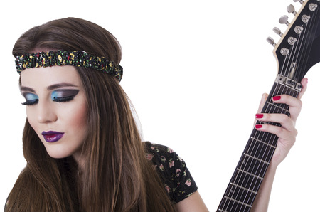 anarchism: Beautiful rocker punk girl with colorful makeup holding electric guitar isolated on white