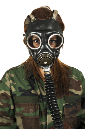 Young military woman wearing gas mask isolated on white photo