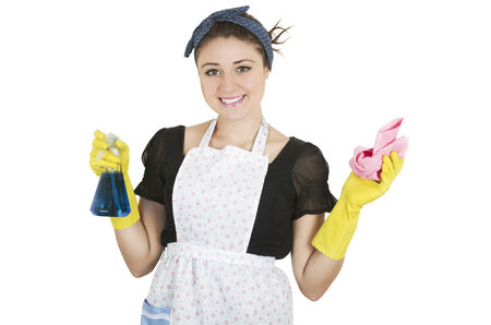 cleaning products: Young happy girl wearing apron and holding cleaning products isolated on white