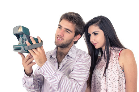 love pic: Cute couple taking photos with instant old camera isolated on white
