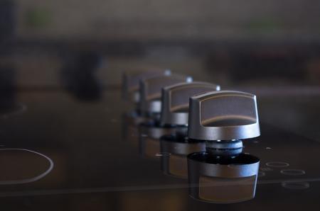 closeup shot of elegant and new stove knobs photo
