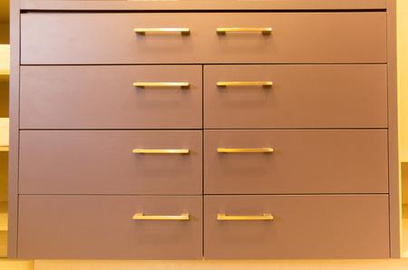 practical: practical brown display drawers with metallic handles