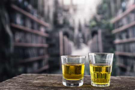 scotish: Two glass shots with yellow liqour resembling whiskey