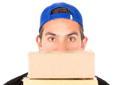 closeup of mans face with boxes in front of him isolated on white photo