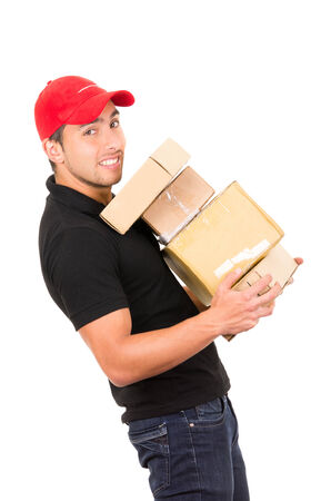 happy handsome friendly confident delivery manwith red cap carrying boxes isolated on white photo