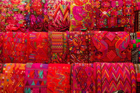 traditional mayan textiles on s msrket stall in antigua guatemala photo