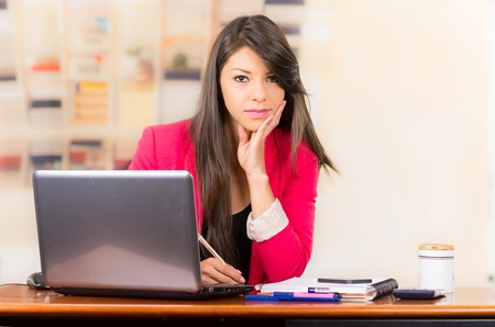 Beautiful young brunette girl student businesswoman professional working with laptop