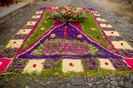 semana santa: religious handmade easter carpets made from colored sawdust fruits and flowers in antigua guatemala