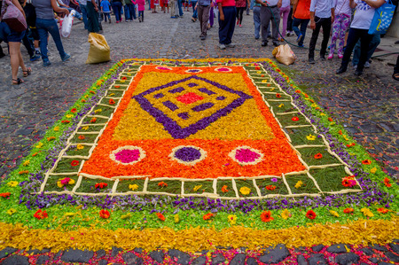 semana santa: detailed handmade easter carpets made from colored sawdust fruits and flowers in antigua guatemala